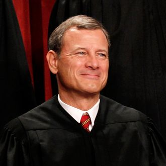 FILE - In this Oct. 8, 2010 file photo, Chief Justice John Roberts is seen during the group portrait at the Supreme Court Building in Washington. Breaking with the court's other conservative justices, Roberts announced the judgment that allows the law to go forward with its aim of covering more than 30 million uninsured Americans. Roberts explained at length the court's view of the mandate as a valid exercise of Congress' authority to