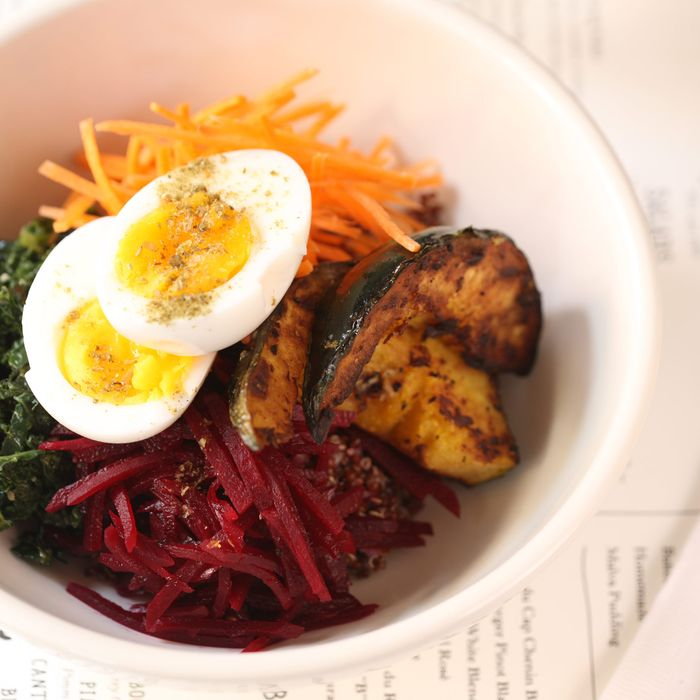 Grain bowl: red quinoa, seasonal vegetables, boiled egg, and sweet-soy vinaigrette.