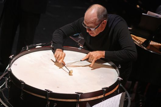 "International Contemporary Ensemble performs an all-Pauline Oliveros program at the Clark Studio Theater as part of Mostly Mozart Festival on Tuesday night, August 20, 2013.  This image: Steven Schick performing ""Concerto for Bass Drum and Ensemble.""   (Photo by Hiroyuki Ito/Getty Images)"