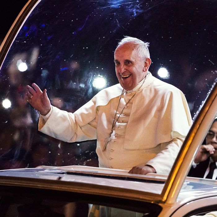 Pope Francis waves to the faithful upon his arrivalin Manila city on January 15, 2015 in Manila, Philippines. Pope Francis will visit venues across Leyte and Manila during his visit to the Philippines from January 15 - 19. The visit is expected to attract crowds in the millions as Filipino Catholics flock to catch a glimpse of the leader of the Catholic Church in the Philippines for the first time since 1995. The Pope will begin the tour in Manila, then travelling to Tacloban to visit areas devastated by Typhoon Haiyan before returning to Manila to hold a mass at Rizal Park. The Philippines is the only Catholic majority nation in Asia with around 90 percent of the population professing the faith.