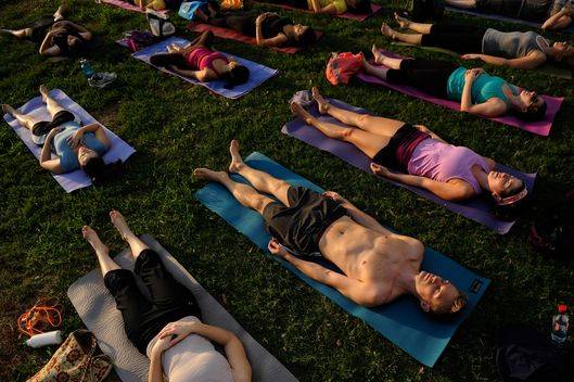 "WASHINGTON, DC - August 31:  Troy Urman, 29, bottom right, and others participate in the final session of Lululemon Athletica's ""Yoga in the Park"" on Wednesday August 31, 2011 at Dupont Circle in Washington, DC.  Over ninety people participated in the free event.  This was the final session in the series which began in May and took place on Wednesday each week.  (Photo by Matt McClain/For The Washington Post via Getty Images)"
