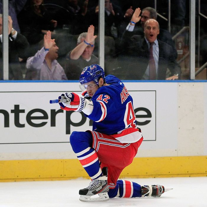 Artem Anisimov #42 of the New York Rangers celebrates scoring a goal in the second period against the Tampa Bay Lightning at Madison Square Garden on December 8, 2011 in New York City.
