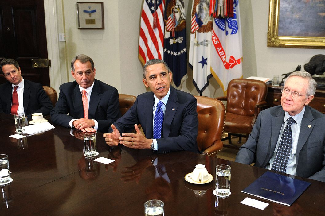 U.S. President Barack Obama (2nd L) speaks as U.S. Treasury Secretary Tim Geithner (L), Speaker of the House John Boehner (R-OH) (2nd L) and Senate Majority Leader Harry Reid (D-NV) looks on during a meeting with bipartisan group of congressional leaders in the Roosevelt Room of the White House on November 16, 2012 in Washington, DC. Obama and congressional leaders of both parties are meeting to reportedly discuss deficit reduction before the tax increases and automatic spending cuts go into affect in the new year.