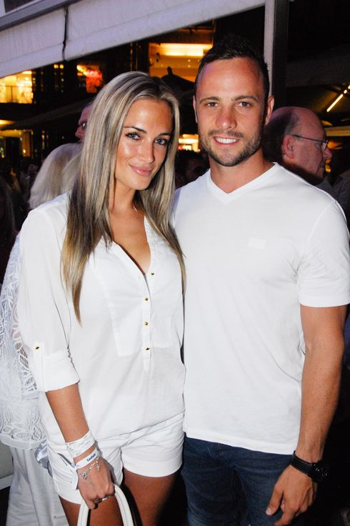 "A picture taken on January 26, 2013 shows Olympian sprinter Oscar Pistorius posing next to his girlfriend  Reeva Steenkamp at Melrose Arch in Johannesburg. South Africa's Olympic sprinter Oscar ""Blade Runner"" Pistorius was taken into police custody on February 14, 2013, after allegedly shooting dead his model girlfriend having mistaken her for an intruder at his upscale home."