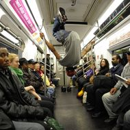 New York City Subway dancer Marcus Walden ( Mr Wiggles)  performs with other members of his dance crew November 23, 2010. The dance crew of Donte Steele (Thebestuknow); Tamiek Steele ( B/Boy LJ) and Marcus Walden ( Mr Wiggles) perform their roughly 45-second routine between stops on the train running from 125th Street in Harlem to the Brooklyn Bridge.