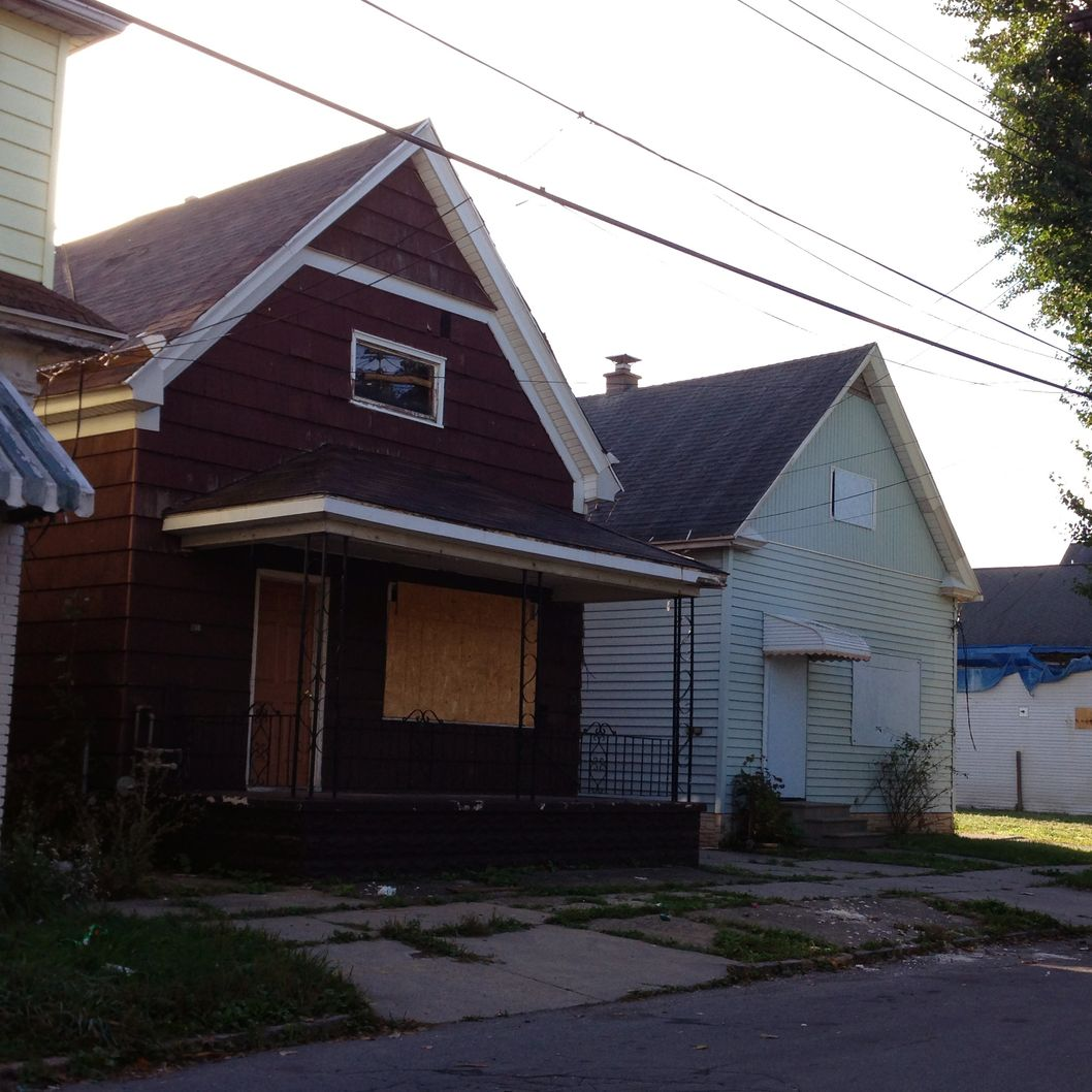 These homes on Deshler Street in Buffalo, N.Y. are among five houses on the street that were owned by Theresa Anderson and used in her drug trafficking business. Anderson, 58, faces 14 to 17 1/2 years in prison when she is sentenced Oct. 8 for running a 12-year operation that monopolized crack cocaine sales in the area and employed her grown children and close acquaintances. (AP Photo/Carolyn Thompson)