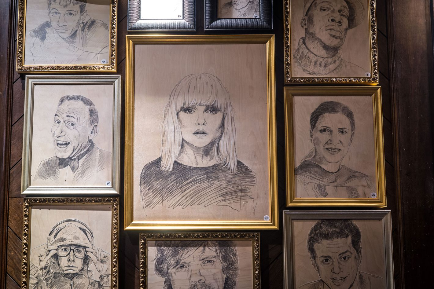 Just a few of the 83 portraits currently hanging in the Suffolk Arms.