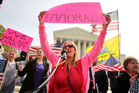 WASHINGTON, DC - MARCH 28:  Tea Party Patriots members, including national coordinator Jenny Beth Martin (2nd L), and Lisa Nancollas (C) of Lewistown, Pennsylvania, shout slogans during a rally in front of the U.S. Supreme Court March 28, 2012 in Washington, DC. This is the last of three-days of oral arguments in front of  the high court over the the Patient Protection and Affordable Care Act.  (Photo by Alex Wong/Getty Images)