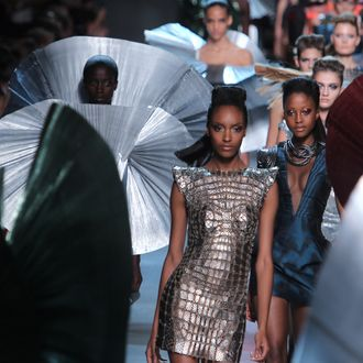 PARIS, FRANCE - OCTOBER 04: Models walk the runway during the Paco Rabanne Ready to Wear Spring / Summer 2012 show during Paris Fashion Week on October 4, 2011 in Paris, France. (Photo by Antonio de Moraes Barros Filho/WireImage)