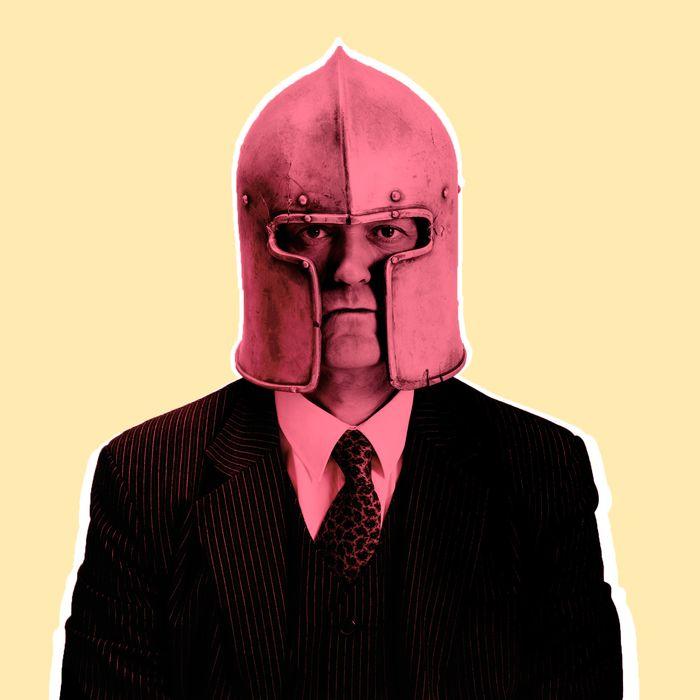 Businessman in medieval helmet