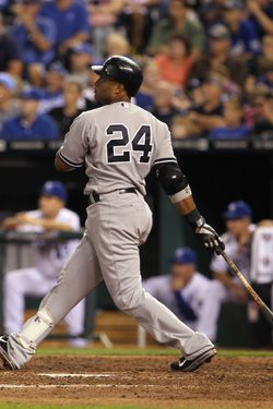 KANSAS CITY, MO - AUGUST 16:  Robinson Cano #24 the New York Yankees hits a 3-run home run during the 4th inning of the game against the Kansas City Royals at Kauffman Stadium on August 16, 2011 in Kansas City, Missouri.  (Photo by Jamie Squire/Getty Images)