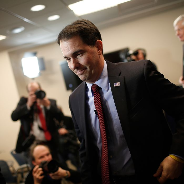 GWisconsin Governor Scott Walker departs after speaking at the American Action Forum January 30, 2015 in Washington, DC. Earlier in the week Walker announced the formation of