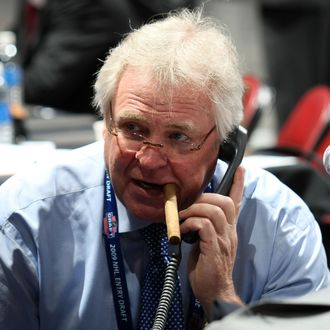 MONTREAL, QC - JUNE 27: General Manager and President Glen Sather of the New York Rangers works the phones during the 2009 NHL Entry Draft at the Bell Centre on June 27, 2009 in Montreal, Quebec, Canada. (Photo by Bruce Bennett/Getty Images) *** Local Caption *** Glen Sather