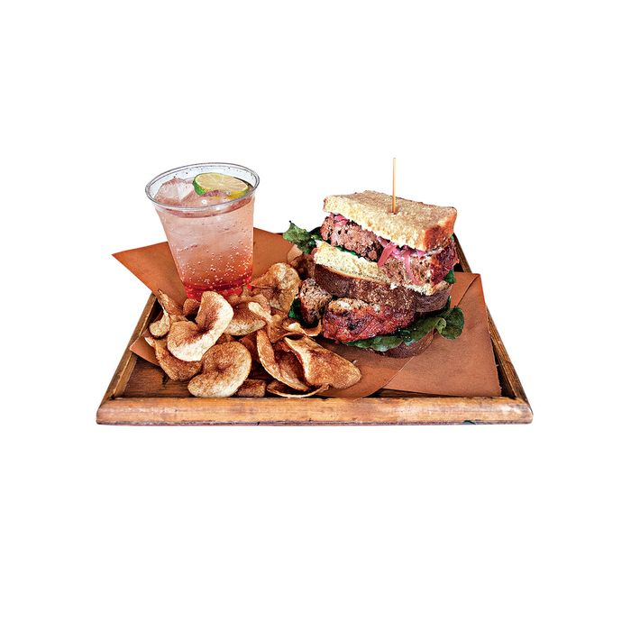 Turkey meatloaf sandwich with pickled red onion, curly endive, and mayonnaise on challah, with housemade potato chips and vanilla pear soda.