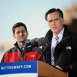LANCASTER, OH - OCTOBER 12: Republican presidential candidate, former Massachusetts Gov. Mitt Romney (R) and Republican vice presidential candidate, U.S. Rep. Paul Ryan (R-WI) speak on stage at a rally on October 12, 2012 in Lancaster, Ohio. The two were campaigning a day after Ryan's debate with U.S. Vice President Joe Biden. (Photo by Jamie Sabau/Getty Images)