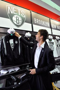 BROOKLYN, NY - APRIL 30: Brook Lopez of the Brooklyn Nets shops during the unveiling of the new logo of the Brooklyn Nets at a press conference on April 30, 2012 at a Modell's Store in Brooklyn, New York. NOTE TO USER: User expressly acknowledges and agrees that, by downloading and or using this Photograph, user is consenting to the terms and conditions of the Getty Images License Agreement. Mandatory Copyright Notice: Copyright 2012 NBAE (Photo by David Dow/NBAE via Getty Images)