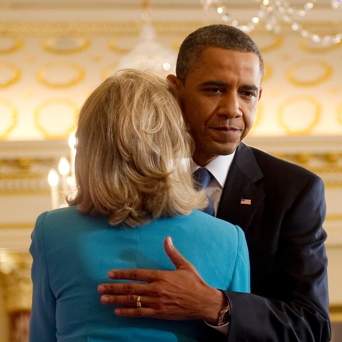US President Barack Obama speaks on the events in the Middle East and North Africa and hugs US Secretary of State Hillary Clinton at the State Department in Washington, DC, May 19, 2011. Obama said the uprisings sweeping the Arab world show that a policy of repression will no longer work. AFP PHOTO/Jim WATSON (Photo credit should read JIM WATSON/AFP/Getty Images)