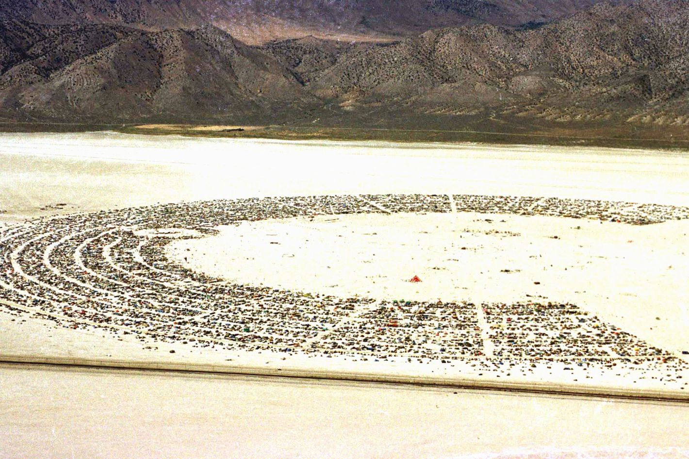 General view of Black Rock City's  Burning Man festival in Nevada 05 September 1999. Founded in 1986 by a group of artists, film makers and photographers, the annual event encourages a collaborative response from its audience and a collaboration between artists. Some twenty thousand people participate in this seven-days event.