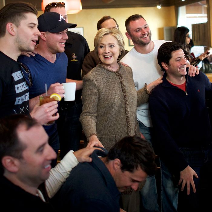 Hillary Clinton, with a bunch of men right where she likes 'em.