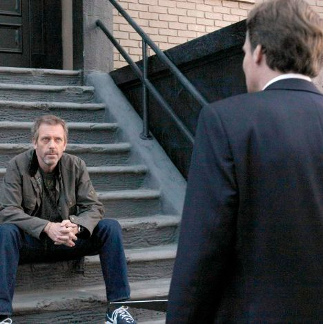 HOUSE: House (Hugh Laurie, L) has some news for Wilson (Robert Sean Leonard, R)
