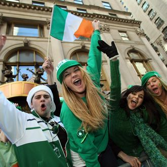 Parade watchers cheer on marching bands as they make their way up 5th Avenue during the St. Patrick's Day Parade on March 17 , 2008 in New York. AFP PHOTO/TIMOTHY A. CLARY (Photo credit should read TIMOTHY A. CLARY/AFP/Getty Images)