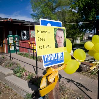 Signs of support with images of U.S. Army Sergeant Bowe Bergdahl are displayed outside Zaney's coffee shop in Hailey, Idaho in this file photo taken May 31, 2014. The political uproar over the prisoner swap that won the release of Bergdahl from Taliban captivity intensified on Wednesday when his hometown of Hailey, Idaho canceled plans for a rally celebrating his return amid allegations that he deserted. REUTERS/Patrick Sweeney/Files (UNITED STATES - Tags: SOCIETY MILITARY POLITICS) --- Image by ? PATRICK SWEENEY/Reuters/Corbis