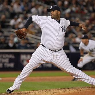 NEW YORK, NY - OCTOBER 06: CC Sabathia #52 of the New York Yankees throws a pitch against the Detroit Tigers during Game Five of the American League Championship Series at Yankee Stadium on October 6, 2011 in the Bronx borough of New York City. (Photo by Nick Laham/Getty Images)