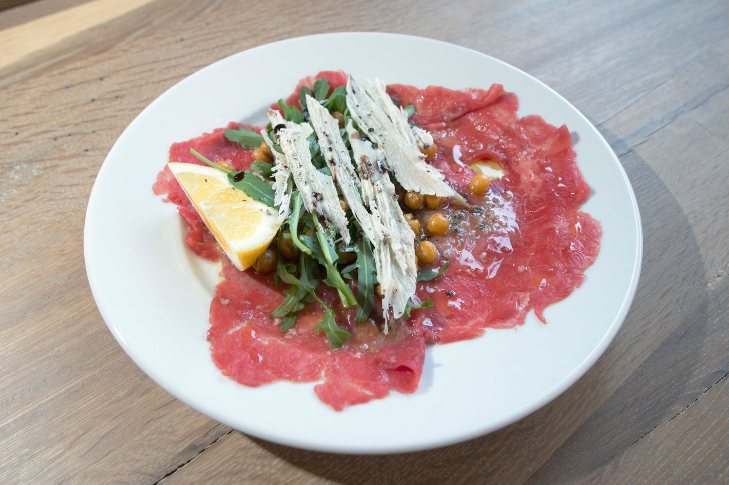 Carpaccio with fried chickpeas, arugula, and aged balsamic.