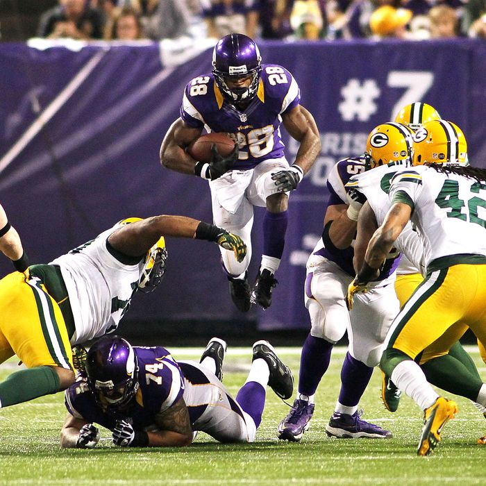 Adrian Peterson #28 of the Minnesota Vikings runs against the Green Bay Packers on December 30, 2012 at Mall of America Field at the Hubert H. Humphrey Metrodome in Minneapolis, Minnesota. The Vikings defeated the Packers 37-34.