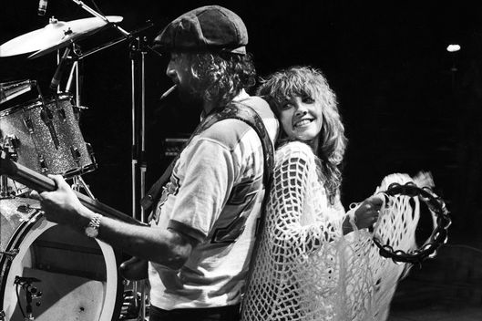 Members of rock group Fleetwood Mac (L-R): John McVie and Stevie Nicks performing in recording studio.  (Photo by Marvin Lichtner/The LIFE Images Collection/Getty Images)