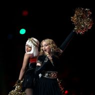 INDIANAPOLIS, IN - FEBRUARY 05: Nicki Minaj and Madonna perform during the Bridgestone Super Bowl XLVI Halftime Show at Lucas Oil Stadium on February 5, 2012 in Indianapolis, Indiana. (Photo by Jamie Squire/Getty Images)