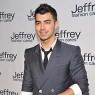 Musician Joe Jonas attends the Jeffrey Fashion Cares 2012 at the Intrepid Aircraft Carrier on March 26, 2012 in New York City.