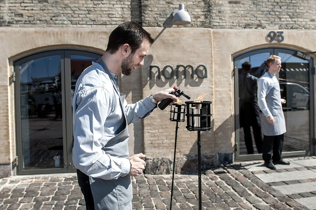A staff member lights a candle outside Noma restaurant in Copenhagen on May 1, 2012. Denmark's Noma restaurant has been named the best in the world for a third year running in an international survey that also gave top rankings to establishments in Spain, Brazil and Italy.