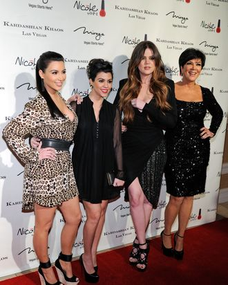 (L-R) Television personalities Kim Kardashian, Kourtney Kardashian, Khloe Kardashian and Kris Jenner arrive at the grand opening of the Kardashian Khaos store at the Mirage Hotel & Casino December 15, 2011 in Las Vegas, Nevada.