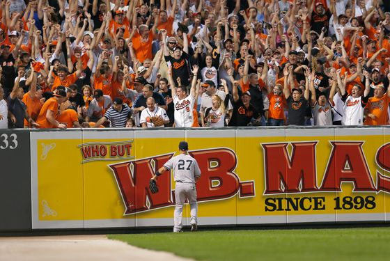 BALTIMORE, MD - SEPTEMBER 06: Left fielder Raul Ibanez #27 of the New York Yankees looks on as fans celebrate a three RBI home run hit by Matt Wieters #32 of the Baltimore Orioles during the first inning at Oriole Park at Camden Yards on September 6, 2012 in Baltimore, Maryland.  (Photo by Rob Carr/Getty Images)