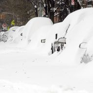 A man walks through the snow in Manhattan's East Village December 27, 2010 in New York City.