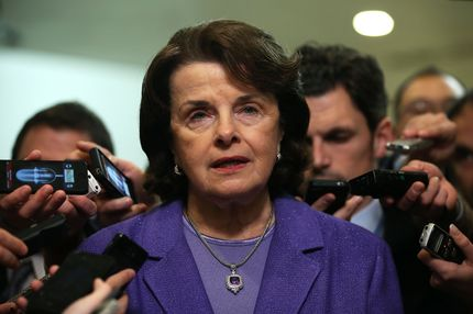 WASHINGTON, DC - NOVEMBER 16:  U.S. Select Committee on Intelligence chairwoman Sen. Dianne Feinstein (D-CA) speaks to members of the media after a hearing on the Benghazi attack November 16, 2012 on Capitol Hill in Washington, DC. Former Central Intelligence Agency (CIA) Director David Petraeus testified before the committee about the September 11 attacks on the American diplomatic compound in Benghazi, Libya, that killed Ambassador Christopher Stevens and three other Americans.  (Photo by Alex Wong/Getty Images)