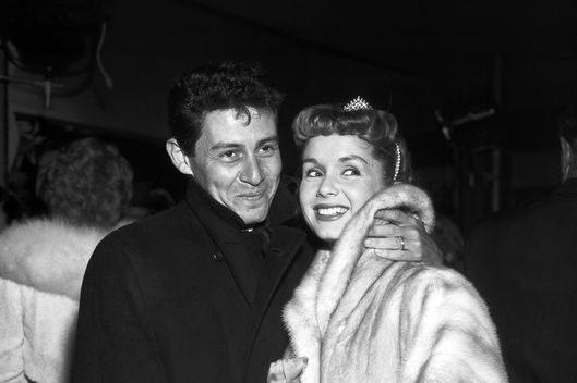 "Debbie Reynolds and Eddie Fisher attend the premiere of their movie ""Bundle of Joy"" on December 22, 1956 in Hollywood, California."