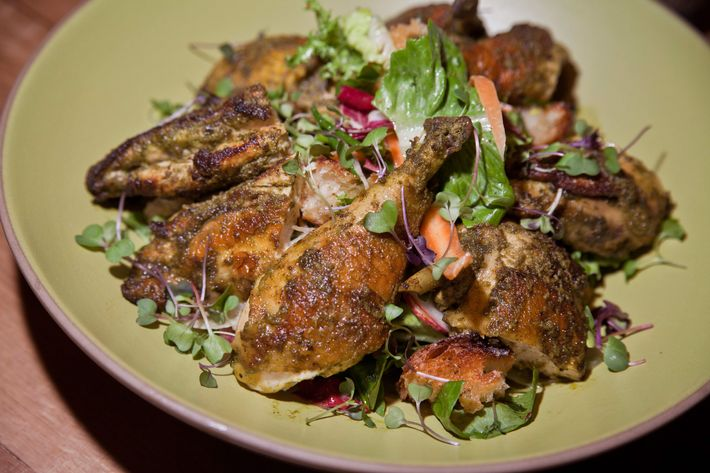 Herb-roasted chicken with crouton salad.