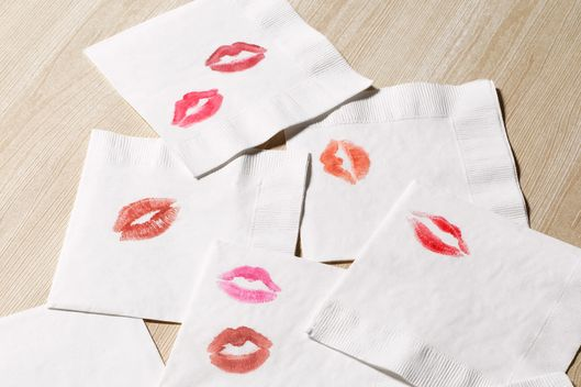 Colored kiss imprints on white napkins