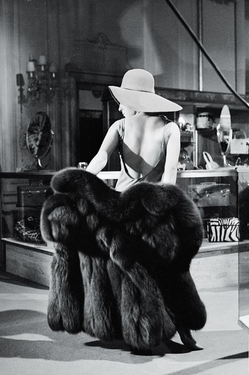 American singer and actress Barbra Streisand tries on a fur coat as she tapes a scene inside the Fifth Avenue department store Bergdorf Goodman for her 'My Name is Barbra' television special, New York, New York, April 21, 1965.  The special aired on CBS on April 28, 1965. (Photo CBS Photo Archive/Getty Images)