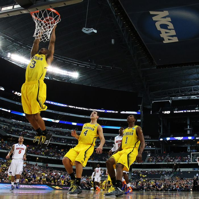 Trey Burke #3 of the Michigan Wolverines goes up against the Florida Gators in the first half during the South Regional Round Final of the 2013 NCAA Men's Basketball Tournament at Dallas Cowboys Stadium on March 31, 2013 in Arlington, Texas.