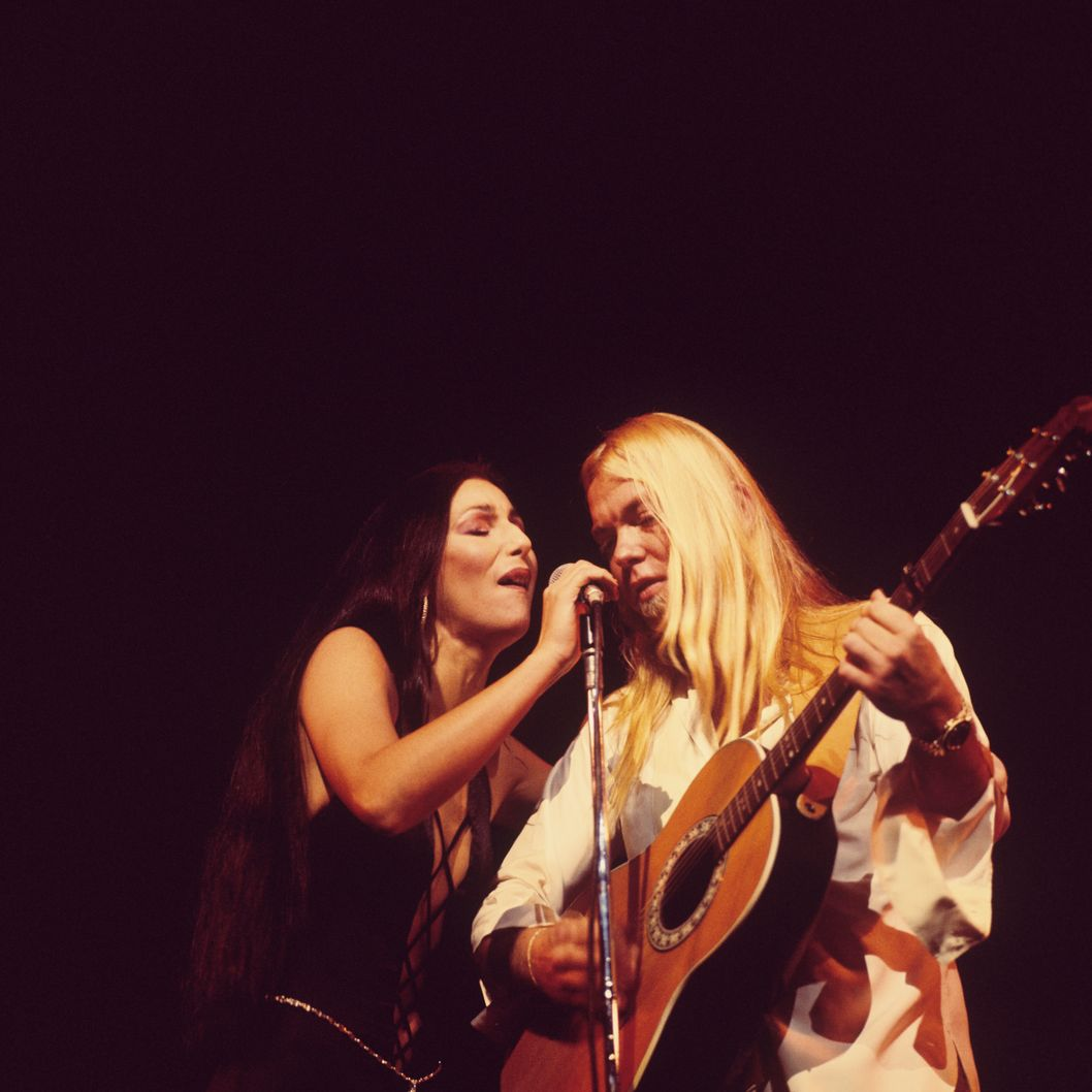 Cher and Gregg Allman perform on stage at the Rainbow Theatre in London, England