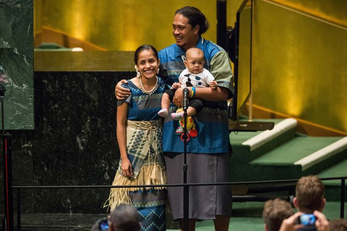 Kathy Jetnil-Kijiner, a civil society representative from the Marshall Islands, recieves a standing ovation with her husband and child after speaking at the United Nations Climate Summit on September 23, 2014 in New York City.