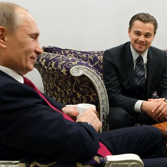 Russian Prime Minister Vladimir Putin (L