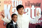 "Chinese actor and producer Jackie Chan (C) and US actor and Will Smith's son Jaden Smith pose for photographers upon their arrival prior to the premiere of the film ""The Karate Kid"" on July 25, 2010 at the Grand Rex in Paris. AFP PHOTO BORIS HORVAT (Photo credit should read BORIS HORVAT/AFP/Getty Images)"
