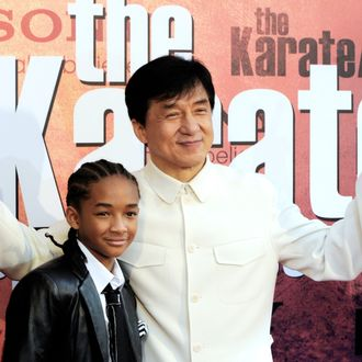Chinese actor and producer Jackie Chan (C) and US actor and Will Smith's son Jaden Smith pose for photographers upon their arrival prior to the premiere of the film