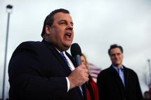 Republican presidential hopeful Mitt Romney (R) looks on as New Jersey Governor Chris Christie speaks during a campaign rally outside a grocery store in Des Moines, Iowa, on December 30, 2001. Romney on Friday ripped President Barack Obama over his annual Hawaii vacation, painting him as out of touch with Americans' economic suffering.  Romney was speaking at a rally four days before this heartland state holds its presidential nominating caucus, the first battle in the state-by-state fight to pick a Republican challenger to Obama in the November 2012 elections. AFP Photo/Jewel Samad (Photo credit should read JEWEL SAMAD/AFP/Getty Images)