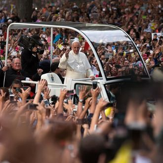 Pope Francis drives through Central Park in a Papal motorcade on September 25, 2015.
