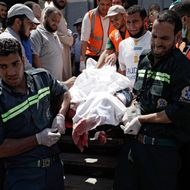CAIRO, EGYPT - JULY 27: The body of a supporter of deposed Egyptian President Mohammed Morsi is carried on a stretcher at a field hospital, after reportedly being killed in fighting between pro-Morsi demonstrators and Egyptian security forces overnight, near the Rabaa al Adweya Mosque in the district of Nasr on July 27, 2013 in Cairo, Egypt. Morsi supporters had gathered at a sit in protest in Nasr City on Friday to continue demonstrations against the overthrow of Morsi, Egypt's first democratically elected leader, on July 3 by the Egyptian Armed Forces. Muslim Brotherhood leaders had called for pro-Morsi protesters to return to the streets on Friday in response to a speech made Wednesday by the Chief of Egypt's Armed Forces, General Abdel Fattah al-Sissi, who called for mass pro-military protests across Egypt on Friday against 'violence and terrorism' and in support of the military's overthrow of Morsi. (Photo by Ed Giles/Getty Images)